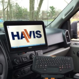 havis touchscreen on dash of a police cruiser with keyboard below