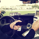officer Ltron di scanner being used in a police cruiser