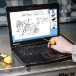 Person looking at a schematic drawing on a Panasonic Toughbook