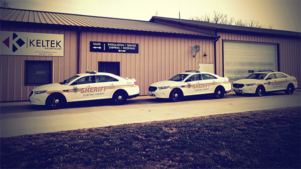 Three sheriff cars parked in front of Keltek