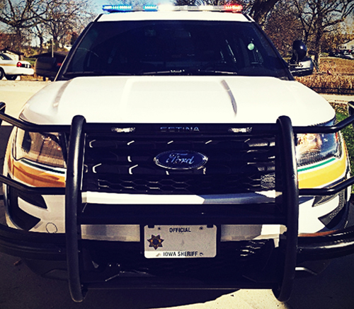 Close Up image of the front of a police cruiser outside the Keltek garage