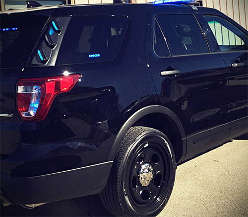 solid black police cruiser outside the keltek garage