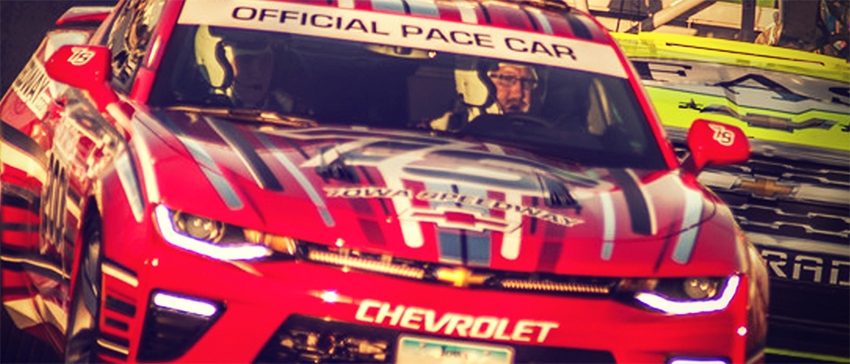 close up of Chevrolet pace car in front of race cars