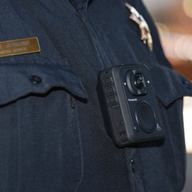panasonic Arbitrator body cam displayed on officers chest